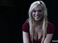 Blonde Samantha Sin in red dress talks about her bondage experience with smile on her nice face