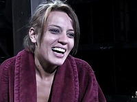 Relaxed Holly Wellin in bathrobe talks about her amazing bondage experience