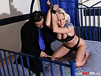 Slave blonde Kathy Anderson in black lingerie gets punished in the middle of a bed