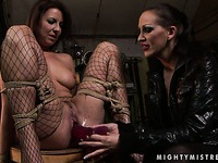 Tied up Maria Bellucci sucks dildo then Mandy Bright stuffs it in her muff