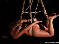Red-haired slave girl Szilvia Lauren gets bound with ropes and raised off the ground