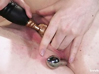 Black haired Nicotine playing with metal anal toy and vibrator on a bed