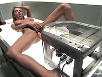 Big breasted bombshell Sammie Rhodes gets her hole fucked by dildo machine on a light table
