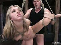 Enslaved Jaelyn Fox gets her leg lifted up, her nipps clamped and her pussy stuffed by Mark Davis