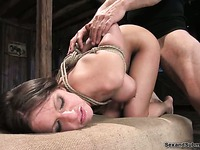 Busty slave girl Rachel Roxxx with hands tied behind her back gets doggystyled by Steven St. Croix