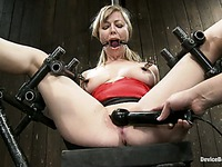Adrianna Nicole with clamps on her natural tits gets her bald spot toyed in device bondage