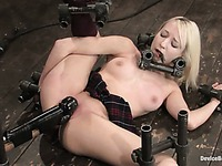Topless Ashley Jane in short skirt and panties shows gymnastic tricks in bondage