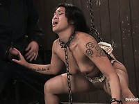 Chain bound asian slave girl Dragon Lily takes master's dick in her hand