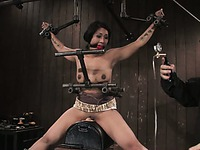 Master uses tit suckers and sybian to please asian bondage girl Dragon Lily