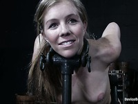 Pierced nippled middle aged slave Tabitha James in tight metal restraints