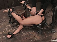 Slave Jade Indica gets her feet fixed over her head before she takes dildo on a pole