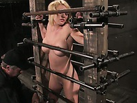 Busty perfect bodied naked blonde Krissy Lynn finds herself between metal bars