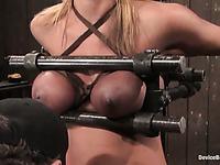 Slave blonde Mellanie Monroe gets her juicy tits squeezed with metal bars