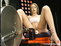Corina Taylor takes off her ultra short skirt after she takes robotic dildo up her pussy