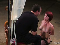 Guy is giving the enema to her slave Lilla Katt and then watches her shitting on the bowl