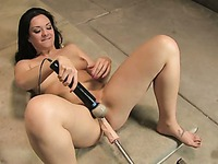 Naked dark haired hottie Sasha Racquelle plays with various sex machines