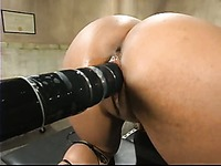 Dark skinned Sydney Capri gets stimulated with tit suckers and fucking machines