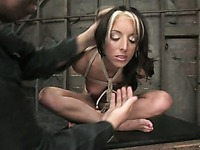 Naked slave Gina Caruso with sexy body gets her breasts tortured in bondage
