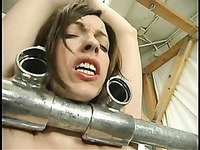 Submissive woman Emily Marilyn gets punished inside and outside the cage