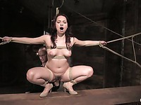 Bound brunette slave Olga Cabaeva gets her mouth and cunt mercilessly dildoed in the dungeon