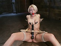 Master rubs vibrator on pink hairless pussy of helpless bound blonde Mallory Rae