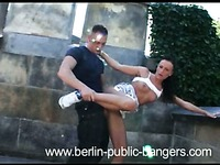 Slutty brunette Gina LatexSlutShow gives blowjob and gets doggystyled in public place