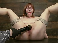 Enslaved redhead cutie Chamille opens her long legs for master and gets her bald spot vibrated