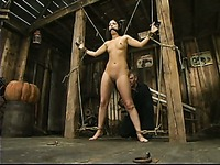 Master eagerly rubs vibrator on smooth pussy of helpless Gia Jordan in the barn