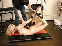 Fair haired helpless girl gets strap bound and hung in the equipped room