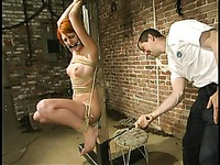 Torque has a great opportunity to have fun with naked and helpless rope tied Ivy Red