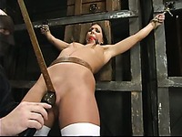 Tied naked slave brunette Julie Night gets her slim body caned from top to toe