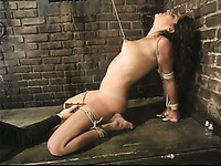 Naked helpless brunette Talia Monet gets a crazy punishment in the dungeon