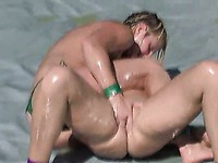 Wet oiled girls Vendetta and Christina Carter wrestle in the burning sun in the afternoon