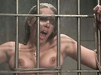 Tied prisoner Delilah Strong gets her feet punished with high pressure water jet