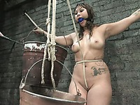 Helpless tied up Dragon Lily gets dunked by Sgt. Major who likes to smother his exotic slave girl
