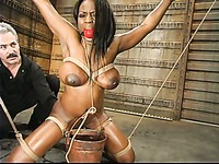 Curvy black slave girl Jada Fire with massive tits in glass tank with water