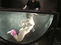Sexy Katja Kassin enjoys swimming in big water tank when water bondage session ends