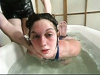 Bound naked slave girl Ginger gets a punishment and has outstanding water fun