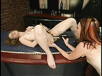 Domina Aly has a good time playing with pussy of obedient Kendra James in a bar