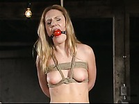 Domme Kimberly Kane in rubber dress fills pussy of helpless Gen Padova with toy
