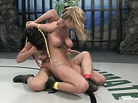 Dragon Lily gets the strapon ready to bang defeated blonde Sammie Rhodes after match