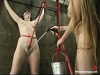 Rope bound Trixie Kitten gets her bare pussy seriously punished by lesbian dominatrix Chanta Rose