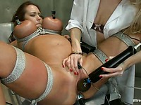 Busty bound Trina Michaels gets her face ridden and her pussy painfully toyed by Ashley Fires