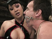 Tied up man Wild Bill gets his ass ruthlessly fucked by asian latex domina Dragon Lily