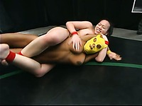 Black wrestler Yellow Kitty keeps her yellow mask on during match with Chyna White