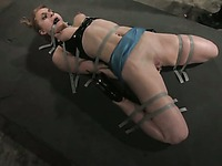Slave girl Tawni Ryden in sexy latex clothes gets shocking water punishment