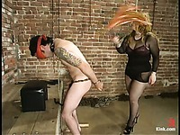Delicious dominatrix Gabrielle dressed in black punishes naked submissive man Brandon