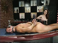 Nude guy Sebastian gets mercilessly punished by redhead dom Kendra James in a bar
