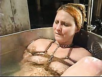 Tied slave blonde Vendetta eats latin pussy of mistress Isis Love in the bathtub