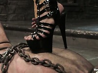 Asian dom Mika Tan in tight fit rubber outfit spends time punishing her male slave